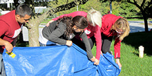 Group navigates the Tarp Turnover team building activity in Pennsylvania