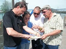 A group discusses their plan during our GeoTrek team building activity in San Francisco Team Building