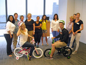 Laughter and fun brought this group together during our charity Buildin' Bikes team building activity