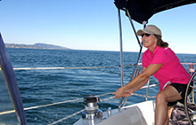 Team member securing a line during our sailing team building activity in Orange County California