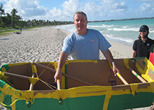 Participant shows off their seaworthy boat during our Build a Boat team building activity in Honolulu Hawaii