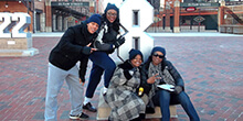 Group poses during our popular GeoTrek team building activity in Baltimore Maryland