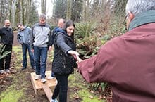 Teammate lends a helping hand during our low ropes team building activities in Seattle Washington